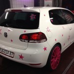 White VW Golf with pink star stickers – Steffi Jasper