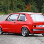 Red Volkswagen Golf Mk1 on silver wheels