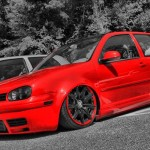 Red Volkswagen Mk4 on black bentley rims