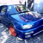 Blue VW Golf with orange wheels – Kevin Hazic