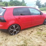 Red Volkswagen Golf MK5 – Christoph Klink