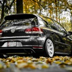 Black Volkswagen Golf Mk6 with white rims