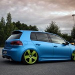 Blue VW Golf Mk6 with green 5 star rims