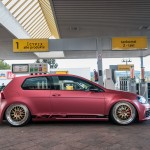 Red KTS VW Golf Mk7 with golden rims