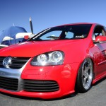 Red VW Golf Mk5 R32 with silver wheels