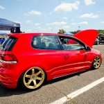 Red VW Golf Mk6 on golden rims