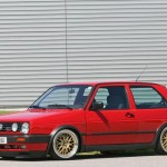 Red VW Golf Mk2 GTI on golden BBS rims