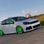 White VW Mk6 GTI on green Porsche RS rims