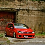 Red Volkswagen Mk6 with black roof