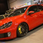 Red Volkswagen Golf VI with black OZ Racing rims