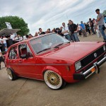 Red Golf Mk1 with golden wheels