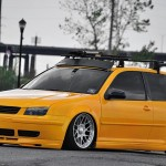 Yellow VW Mk4 with silver wheels and tinted windows