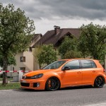 Orange VW Golf Mk6 on black OZ racing wheels