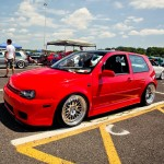 Red Volkswagen Golf Mk4 on silver wheels