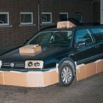 This guy walks around at night pimping random people's cars with cardboard (PHOTOS)